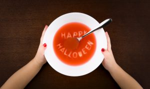 happy Halloween spelled out in soup