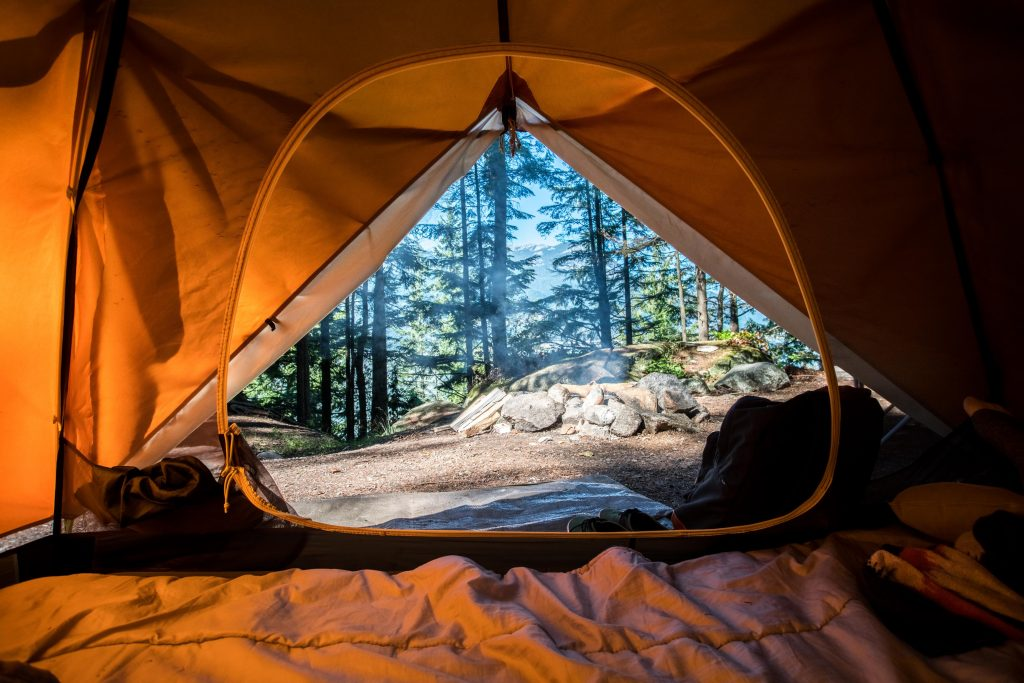 camping tent set up in the woods