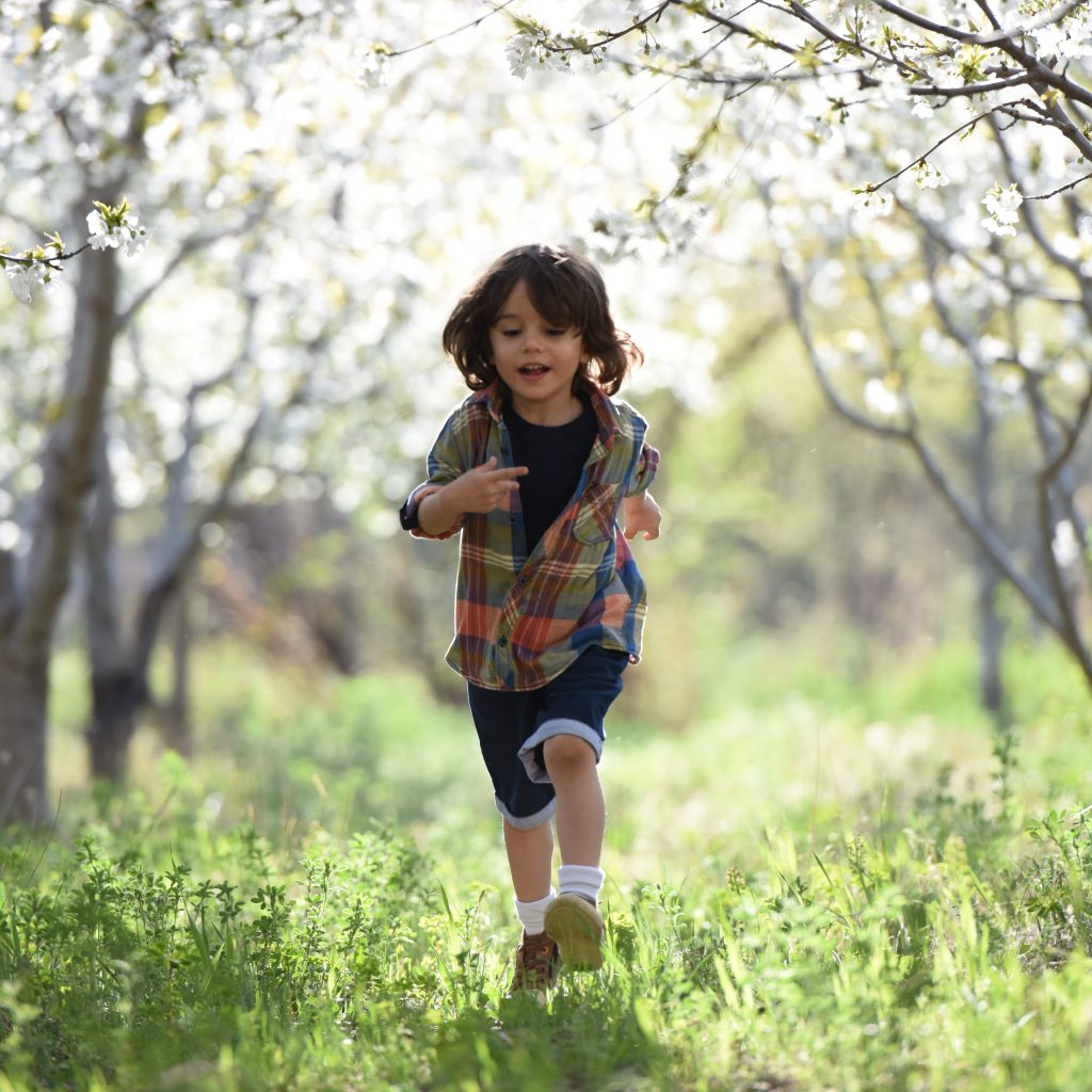 toddler running in the grass