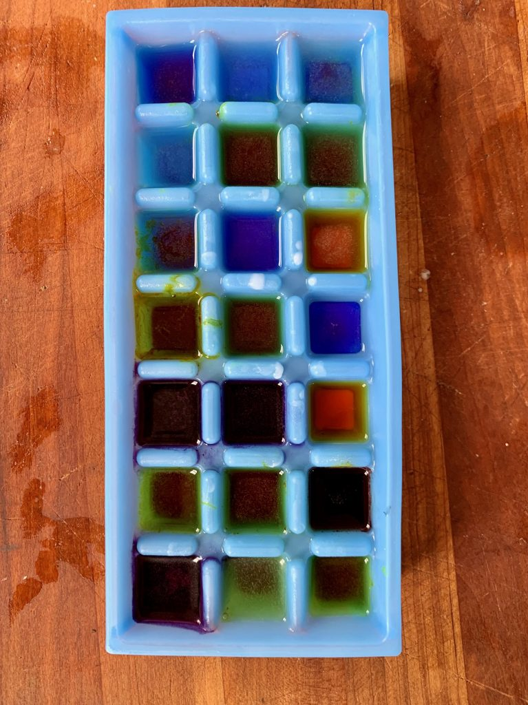 Colored water in ice cube tray