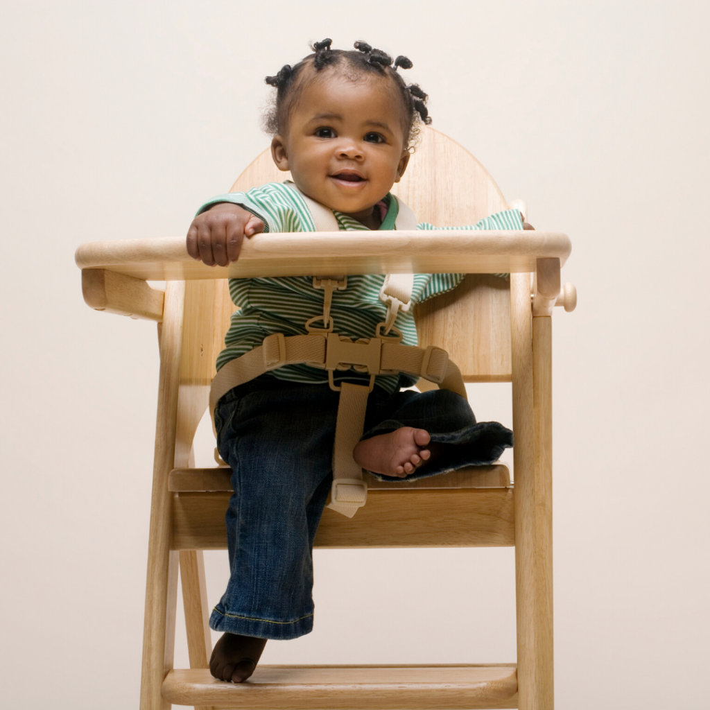 1 year old sitting in a high chair