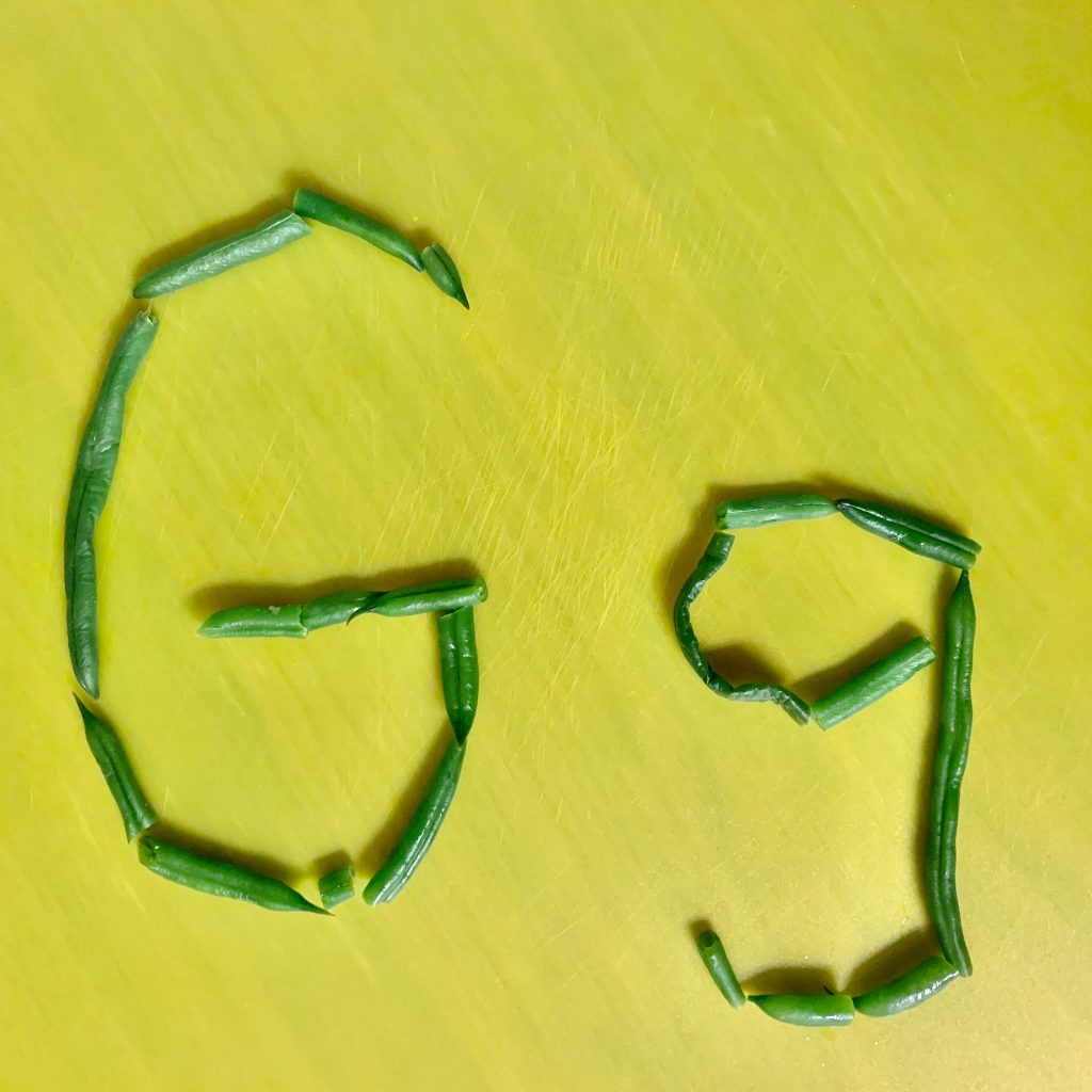 G spelled in green beans