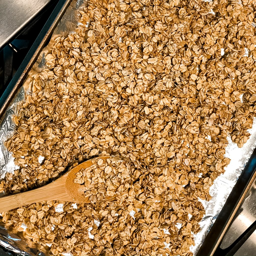 granola on the pan ready for the oven
