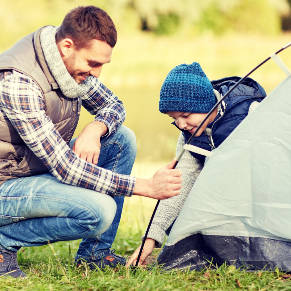 dad and son setting up a tent