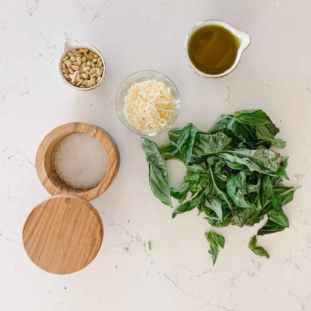 pesto ingredients out on a counter