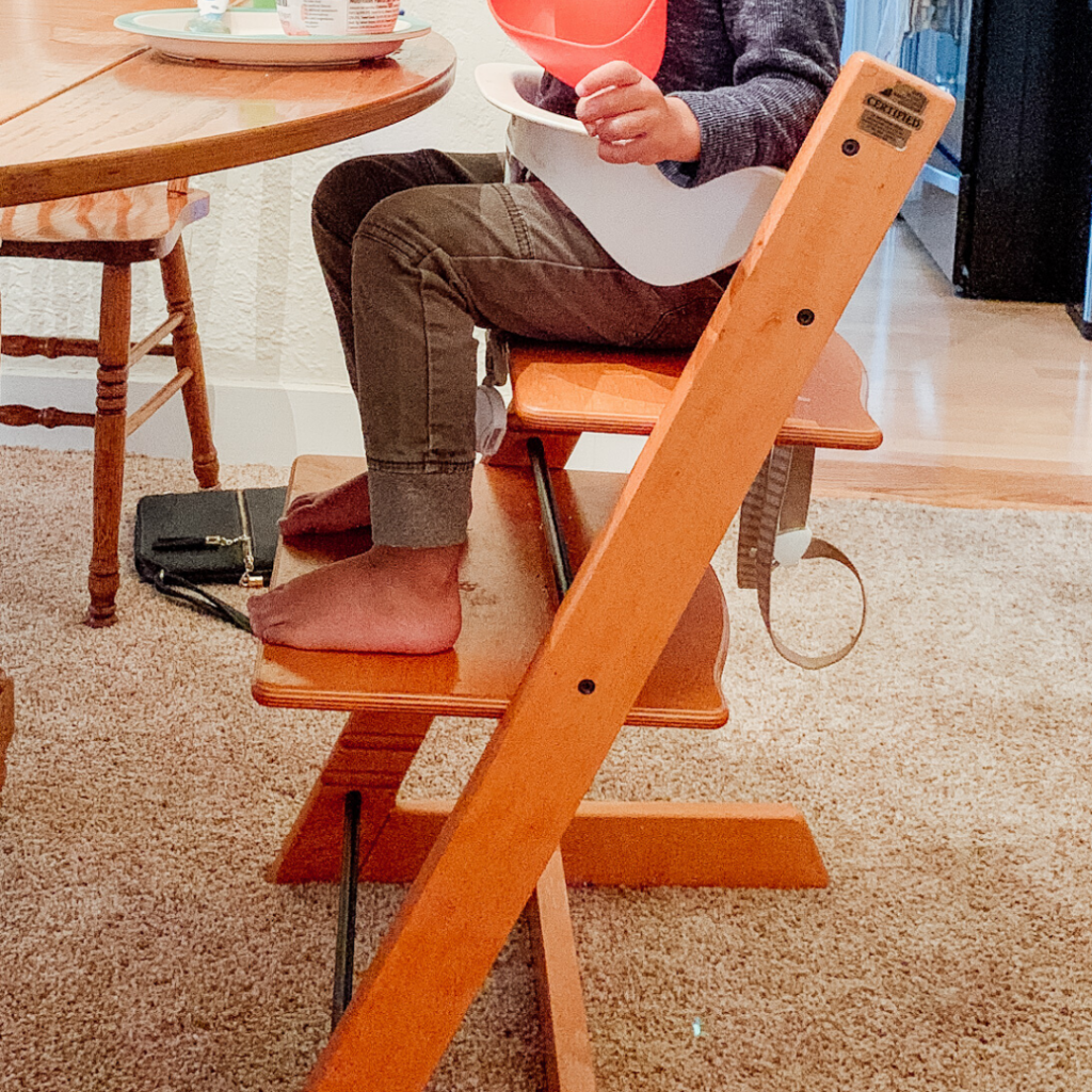 toddler sitting correctly in high chair