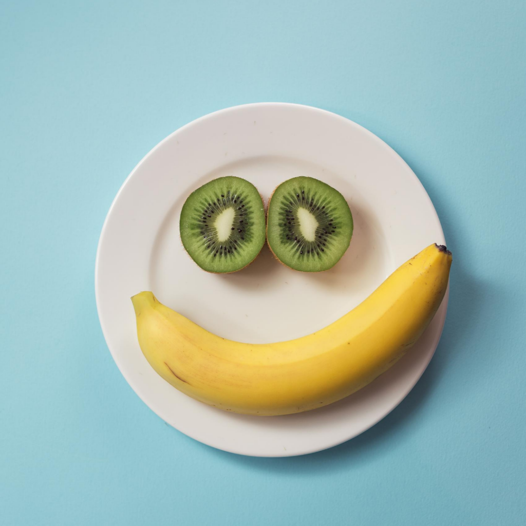 a plate with a fruit smile