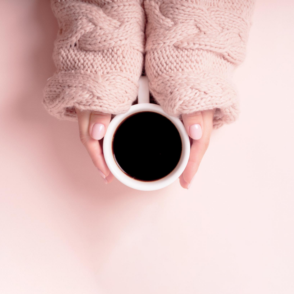 mom holding coffee cup