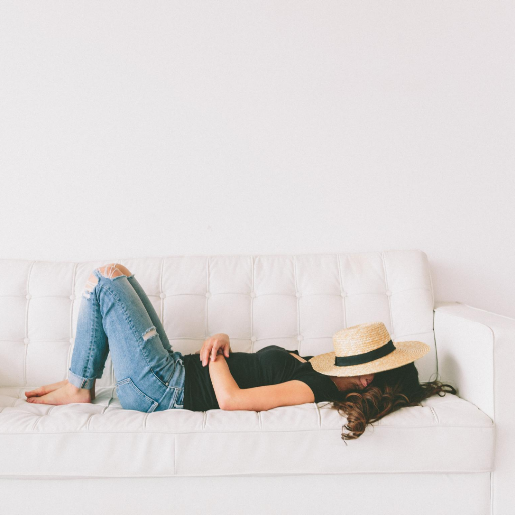 woman resting on a couch