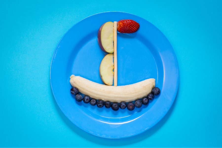 plate with fruit shaped as a boat