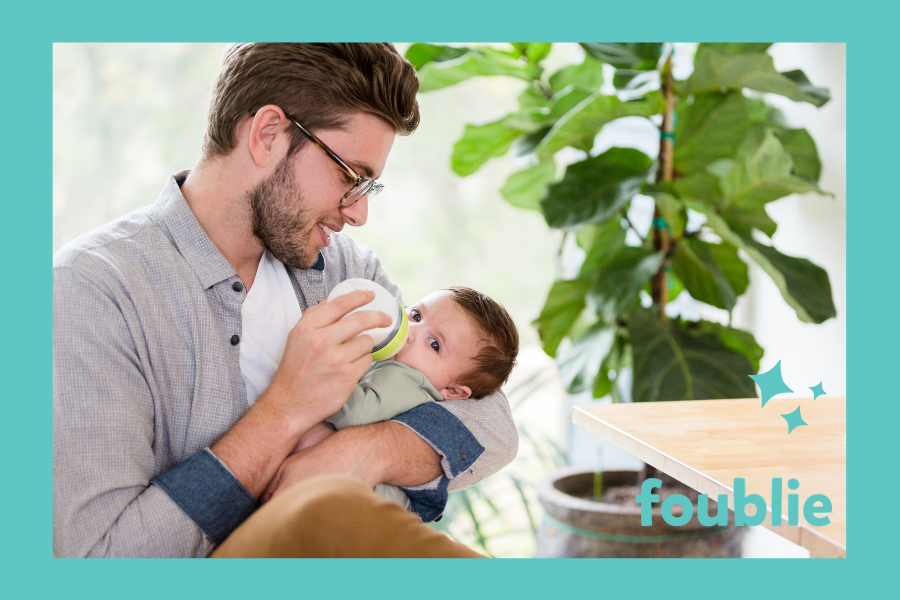 picture of dad feeding a baby
