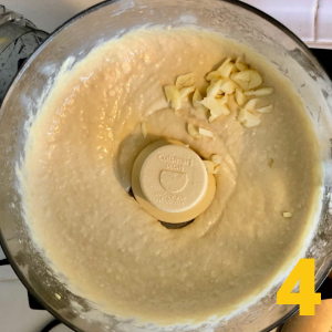 garlic in food processor with chickpea puree