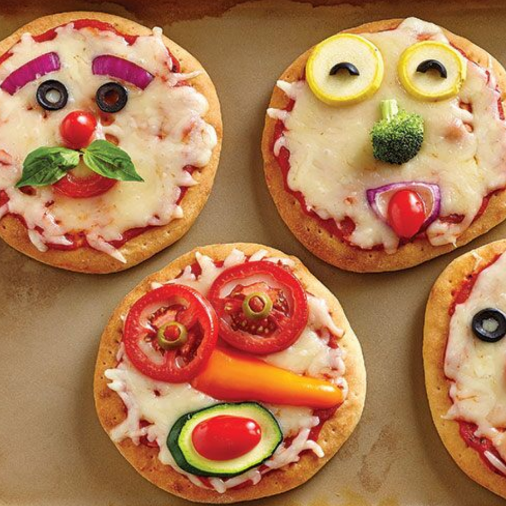 pizzas with faces made of vegetables